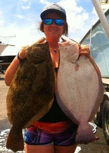 Taryn Leigh Dillon with a nice brace of fluke, one a 7.5-pounder, and the other an 8-pound fish. Watch Hill Outfitters